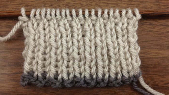 Example of the Super Stretchy Slipknot Cast On in a contrasting color knit on a 1x1 rib swatch