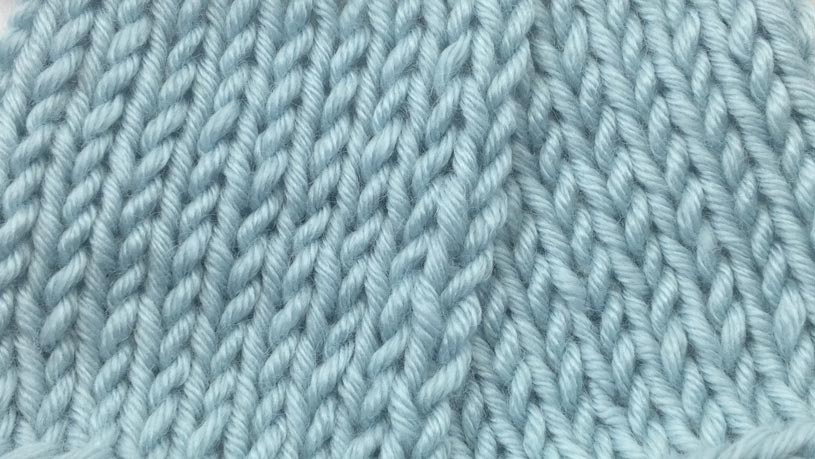 Example of the Purl Two Together Decrease wrong side close up