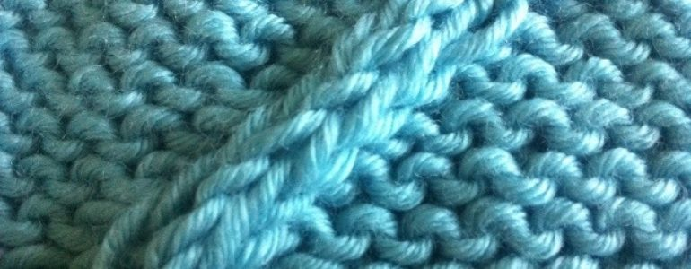 Example of the Twist Four Back Cable Stitch on a Reverse Stockinette Panel